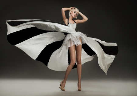 Foto de Beautiful blonde in marvelous dress - Imagen libre de derechos