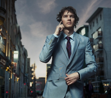 Elegant man posing on a city street