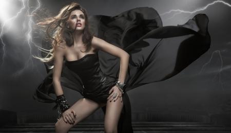 Foto de Gorgeous woman wearing black dress - Imagen libre de derechos