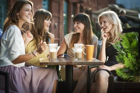 Photo for Four girls enjoying the meeting - Royalty Free Image