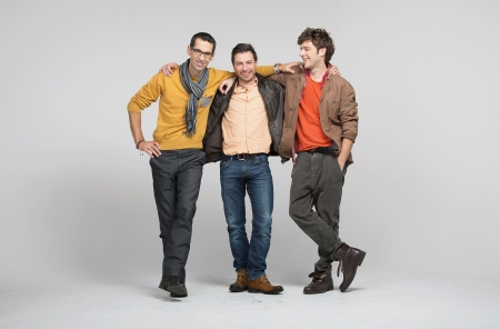 Photo for Male friends smiling and enjoying their company - Royalty Free Image