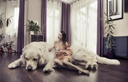 Young lady hugging big dog