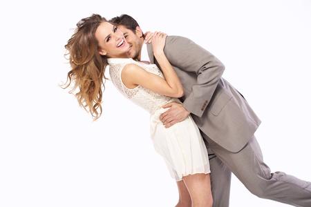 Photo pour Delighted young couple hugging each other - image libre de droit