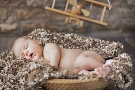 Photo pour Fine picture of cute baby sleeping in toy room - image libre de droit
