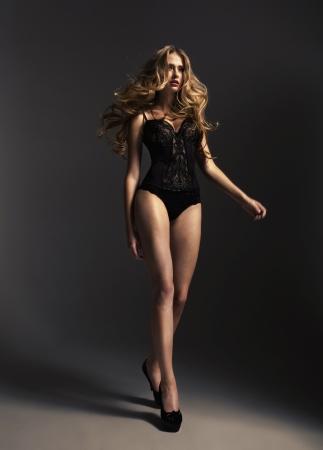Photo pour Tall alluring woman wearing sexy lingerie - image libre de droit