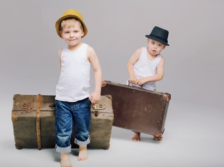 Brothers holding their really heavy luggages