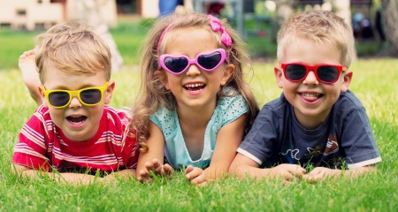 Photo pour Funny picture of three playing children - image libre de droit