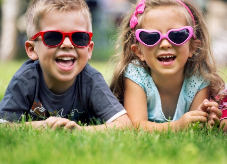 Photo for Cute small children with fancy sunglasses - Royalty Free Image