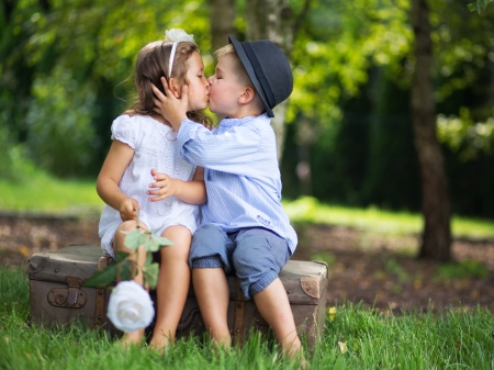 Photo for Cute couple of kids kissing each other - Royalty Free Image
