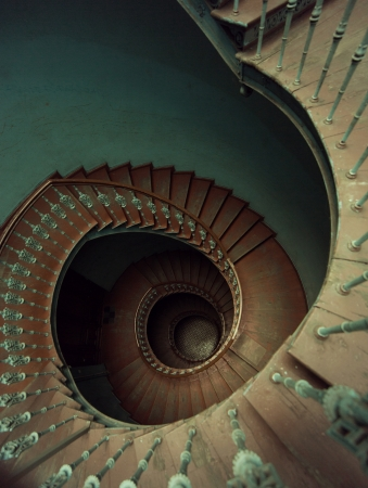 Old wooden spiral stairs in ancient palace