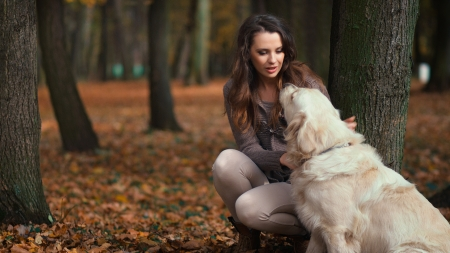 Attractive lady with her nice labrador dog