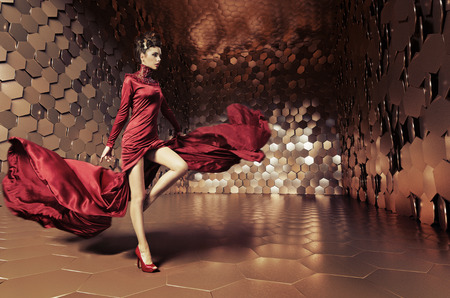 Photo for Glamorous woman with wavy evening dress - Royalty Free Image
