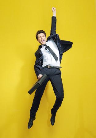 Foto de Handsome succesful businessman in the victory jump - Imagen libre de derechos