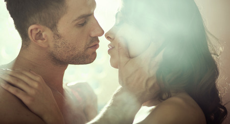 Foto de Young sensual couple during romantic evening - Imagen libre de derechos