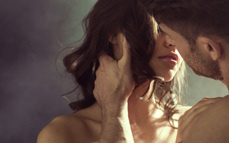 Photo for Sensual woman kissing her handsome husband - Royalty Free Image