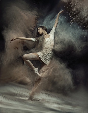 Photo pour Pretty ballet dancer with dust in the background - image libre de droit