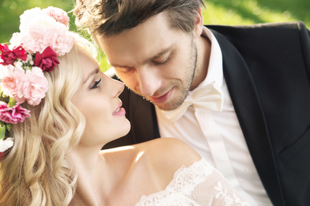 Photo for Delicate young bride with handsome groom - Royalty Free Image