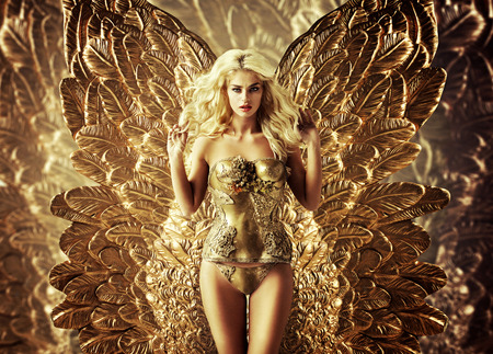 Foto de Blond tempting lady with the golden wings - Imagen libre de derechos