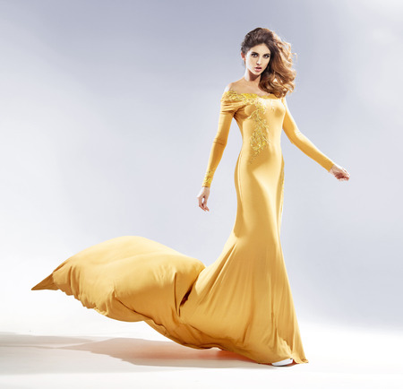 Photo for Attractive woman dressed in a luxury evening gown - Royalty Free Image