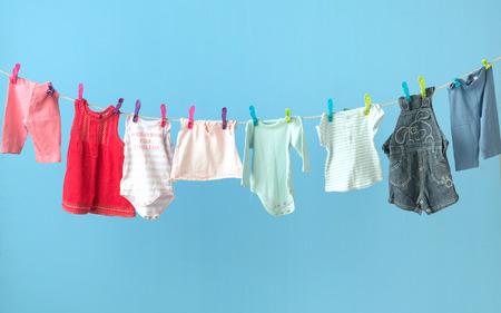 Photo pour Colorful baby's clothing getting dry - image libre de droit