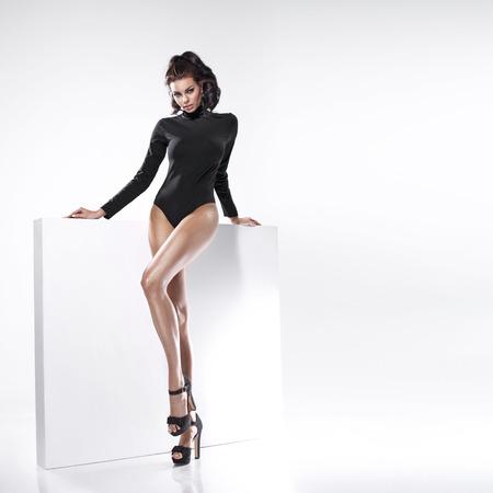 Photo pour Young beautiful lady with tempting legs - image libre de droit