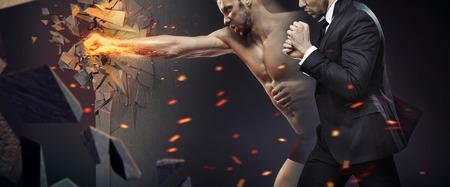 Photo pour Ambitious businessman smashing a barrier - image libre de droit