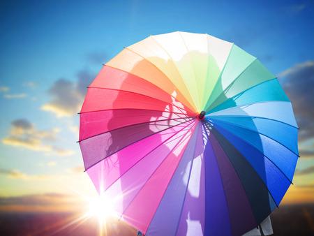 Photo pour Romantic couple behind the colorful umbrella - image libre de droit