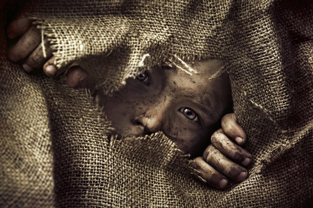 Photo pour Artistic portrait of a poor little kid - image libre de droit