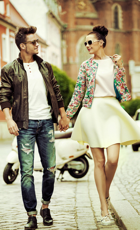 Photo pour Handsome man walking with a lovely girlfriend - image libre de droit