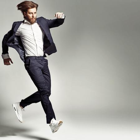 Photo pour Young energetic guy wearing suit - image libre de droit