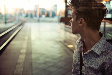 Foto de Calm guy in the retro railway station - Imagen libre de derechos