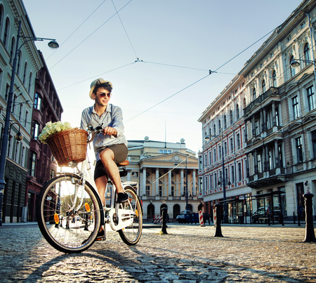 Photo for Young elegant man riding a bicycle - Royalty Free Image