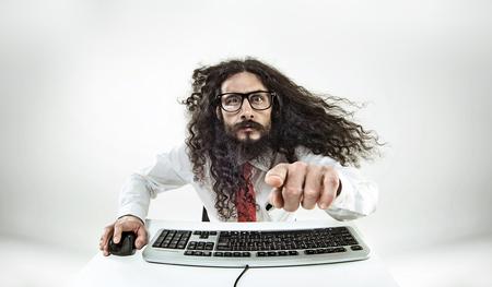 Foto de Portait of a IT scientis isolated in office - Imagen libre de derechos
