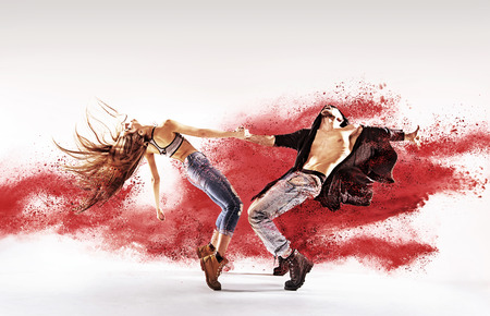 Foto de Talented young dancers sprinkling red sand - Imagen libre de derechos