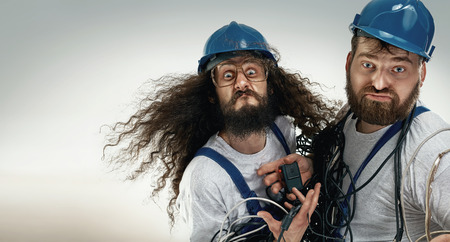 Foto de Portrait of two silly antagionistic engineers - Imagen libre de derechos