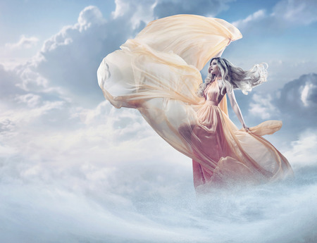 Photo pour Fairy image of a beautiful young woman in the clouds - image libre de droit