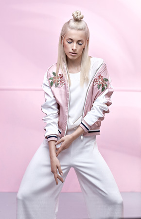 Photo pour Pretty, delicate girl wearing trendy jacket - image libre de droit