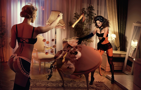 Photo for Two sensual, young ladies fighting in the luxurious hotel's apartment - Royalty Free Image