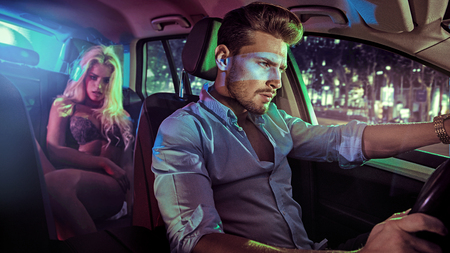 Foto de Sexy couple in an elegant vehicle, at night - Imagen libre de derechos