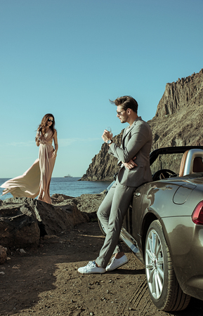 Photo for Young, elegant couple on the luxurious vacation - Royalty Free Image
