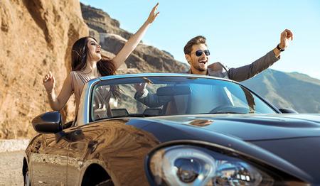 Photo pour Smart, relaxed couple riding a luxurious convertible - image libre de droit