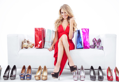 Photo for Fashionable woman with lots of colorful shoes - Royalty Free Image