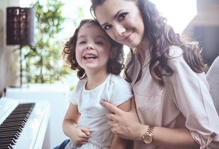 Photo pour Happy mother with a little daughter at home - image libre de droit