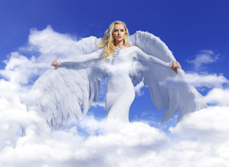 Photo for Conceptual portrait of a young, blond angel flying up to the sky - Royalty Free Image