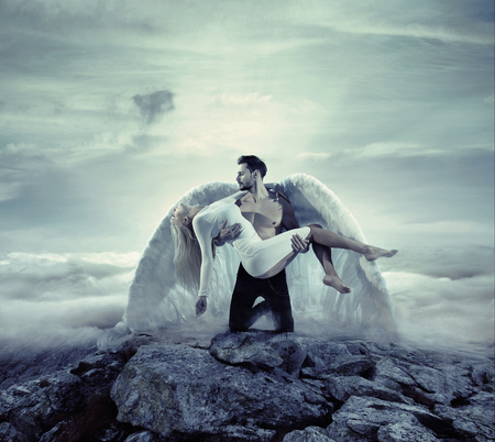 Photo for Handsome archangel carrying an innocent, unconscious woman - Royalty Free Image