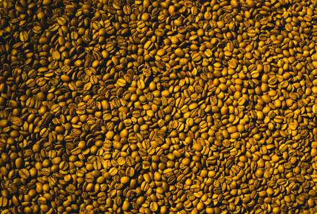 Foto de Freshly roasted aromatic coffee beans in a modern coffee roasting machine. - Imagen libre de derechos