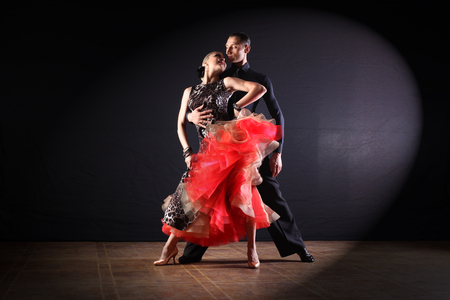 Photo pour dancers in ballroom isolated on black background - image libre de droit