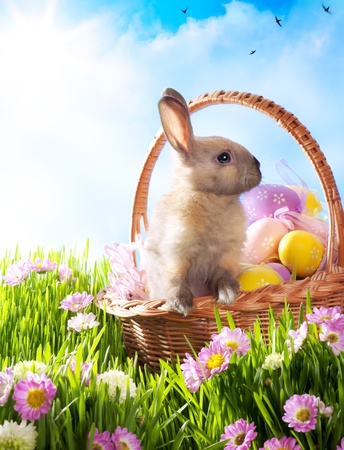 Photo for Easter basket with decorated eggs and the Easter bunny - Royalty Free Image