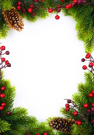 Foto de  christmas frame with fir and Holly berry on white paper background - Imagen libre de derechos