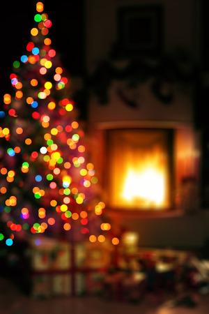 Foto de art Christmas scene with tree gifts and fire in background - Imagen libre de derechos